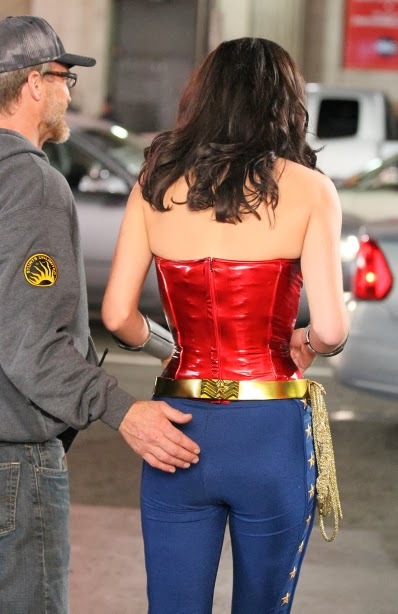 ADrianne Palicki shows that Wonder Woman not only has to watch her back, but her back side!